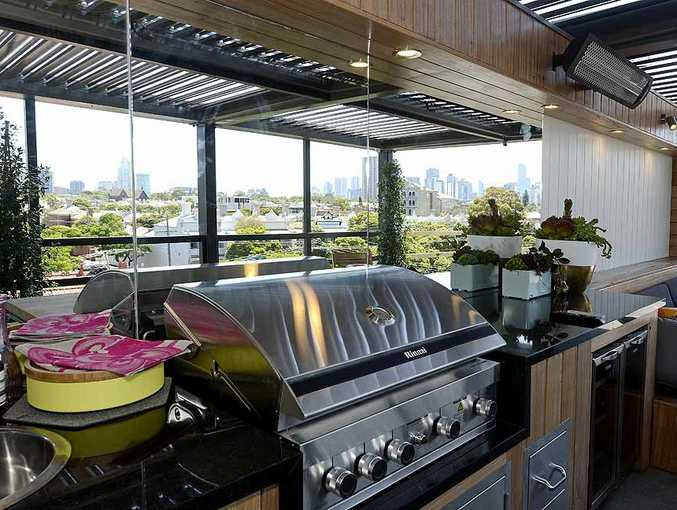 Kyal and Kara's winning rooftop terrace with Melbourne city views.