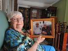 Betty Christensen with a picture of herself and her late husband Roy.