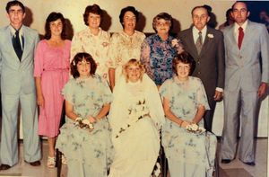 The Christensen family pose for a wedding photo - (back row) Ray, Joan, Kay, Nola, Betty, Roy and Bevan and (front) Carol, Ann and Jill.