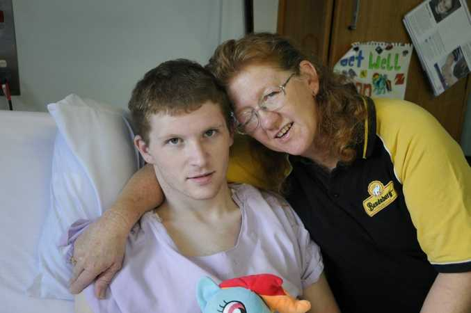 Twenty-one year old, Jeremy Whitnall was badly injured when hit by a truck while riding his bike. his mother Carmel McKIllop, now faces huge battle as the sole carer and income earner. Photo: Bev Lacey / The Chronicle