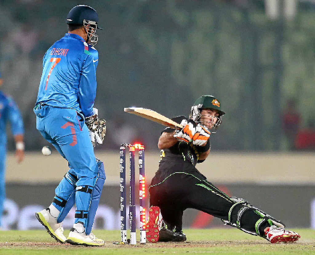 DOWN AND OUT: India captain and wicketkeeper MS Dhoni looks on as Australia's Glenn Maxwell is bowled in the T20 World Cup game.