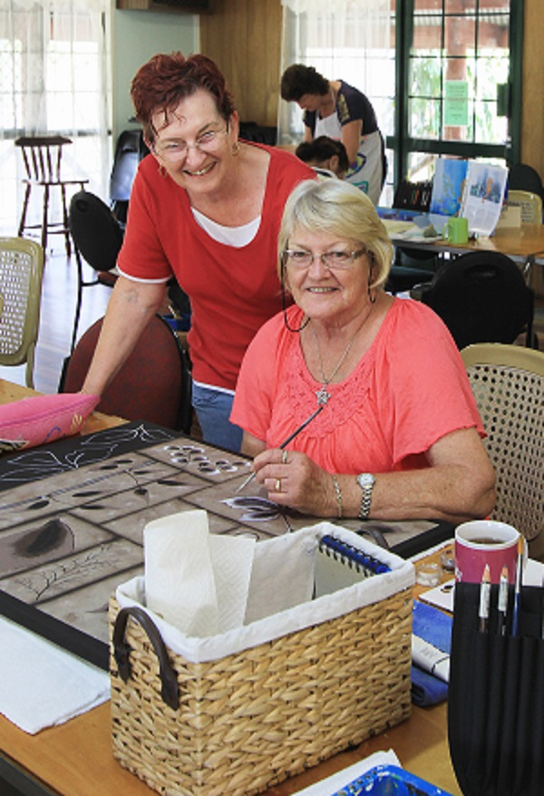 Local artist Sue Crickitt with Kathleen Stutley at a folk art class.
