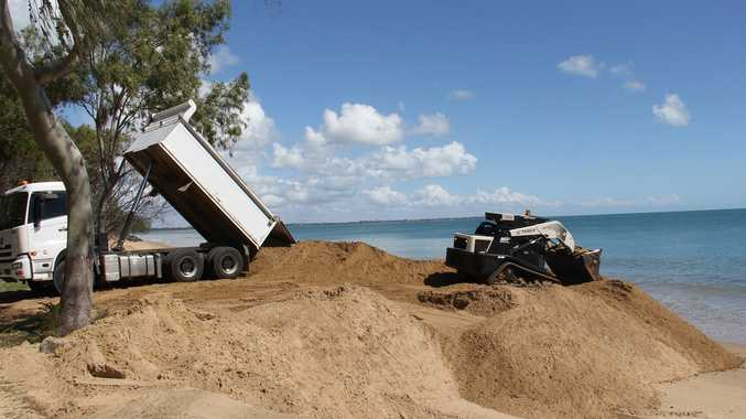 Sand from a stockpile near the Seafront Oval is used to replenish dunes west of the Margaret St groyne in Urangan.