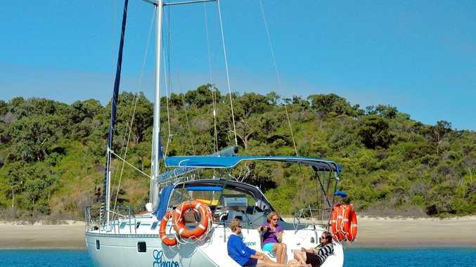 Unwinding on a yacht among the Keppel group of islands. Photo Sail Capricornia