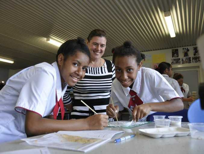 Keeping close watch on their science project are St Saviour's College Year 9 students Christine Giwar (left) and Loraine Rahiria with teacher Dr Tania Van Den Ancker overseeing.