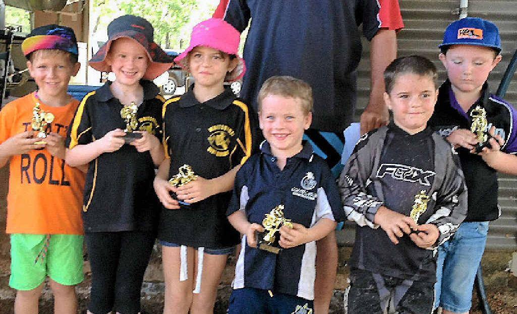 LITTLE LEGENDS: Whitsunday Dirt Riders Braydon Bradford, Hayley Ball, Chole Blacklock, Archie Ferdinand, Braylon Jones and Koen Auer with their awards at Drays Park last Sunday.