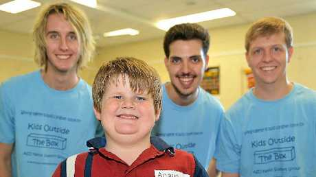 ACTING UP: Front and centre, Angus is one of the many kids taking part in drama workshops this week for young people with Autism Spectrum Disorder run by Delirium Comedy Group – Chris Charteris, Adam Toolin and Michael Fowle.
