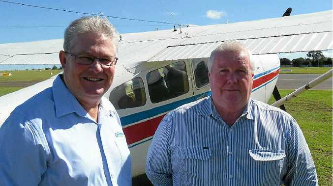 READY FOR TAKE OFF: Condamine Alliance CEO Phil McCullough and general manager programs Andrew McCartney before the flight.
