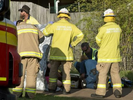Emergency services treat a man run over by a car at a Drayton home.