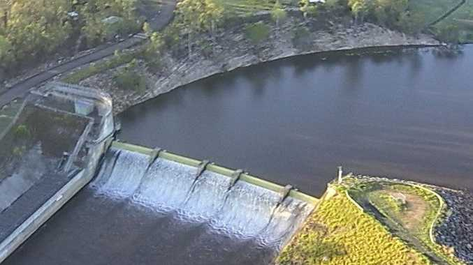 Lenthalls Dam is overflowing after recent heavy rain.