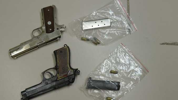 Two semi-automatic handguns were uncovered on an early morning raid in Nanango today.