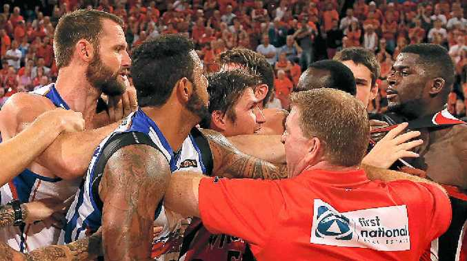 ON COURT BLOW-UP: Wildcats coach Trevor Gleeson and Damian Martin (centre) attempt to separate James Ennis (right) and Anthony Petrie and BJ Anthony of the 36ers as players and coaches from both sides become involved in a melee when the sides met in February.