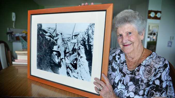 Marjorie Cheek's father's war medals survived the Blue Mountains bush fires after her nephew's house was destroyed by fire and she wants to wear them to the 2015, 100th anniversary Gallipoli celebrations. Marjorie with a photo of her father from Gallipoli.