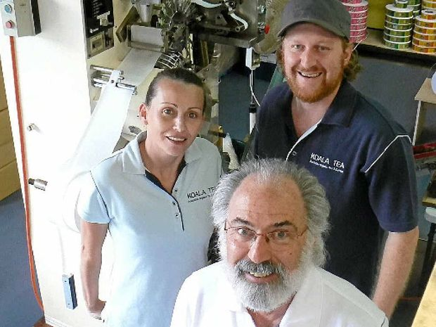 NICHE MANUFACTURING: Howard Rubin, front, with staff Tanya Francis and Brent Evans in front of a tea bagging machine. Photo Jamie Brown / Northern Star.