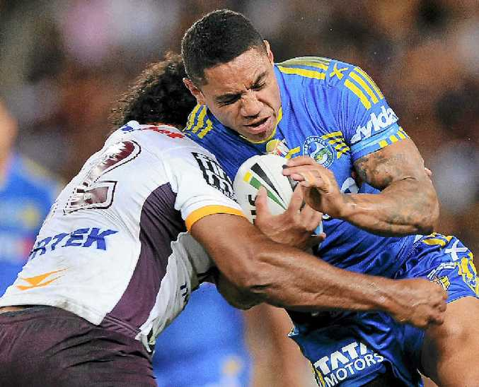 CRUNCH TIME: Willie Tonga of the Eels is tackled by a Brisbane Broncos player at Suncorp Stadium last night.