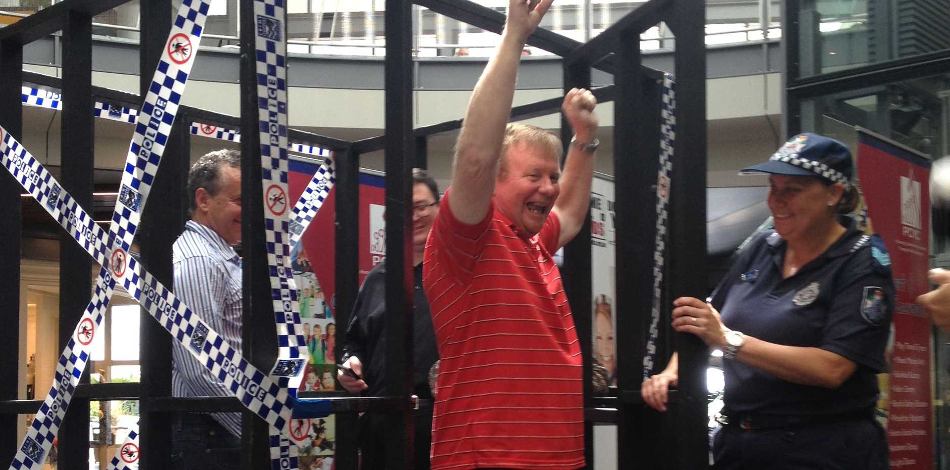 Councillor Frank Gilbert raises the $500 needed to get out of jail at the PCYC's Time 4 Kids event at Caneland Central