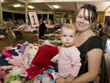 Melinda Stack with her daughter Emily Geraghty looks through clothes at the Childbirth and Parenting Education Association Toowoomba's nearly new sale at Fairholme College, Saturday, April 05, 2014. Photo Kevin Farmer / The Chronicle