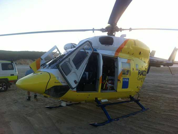 The RACQ CareFlight Rescue helicopter at Double Island Point.