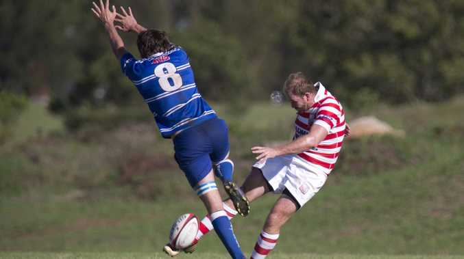 University's Andre Van Staden attempts to charge down a Rangers clearing kick from Tom Simpson during their round-two Risdon Cup match at USQ Oval yesterday.