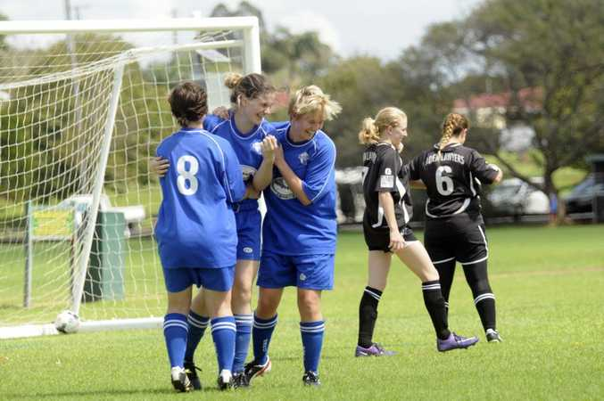 CELEBRATION: Rockville players congratulate Amie Campbell (centre) after scoring against West Wanderers.
