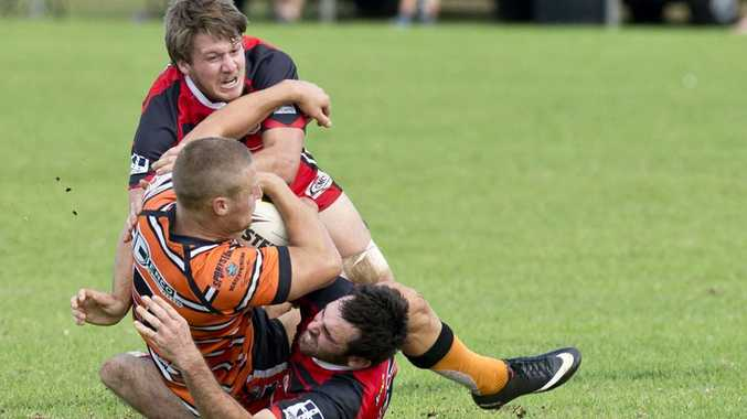 TIED UP: Valleys defenders Josh Hancock and Jake Capewell tackle Souths halfback Ben Loxley at Herb Steinohrt Oval.