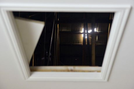 BOLT HOLE: Light streams through a gap in the roof of a Brassall property.