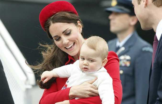 The Duke and Duchess of Cambridge with Prince George disembarking from the RNZAF jet. Photo / Mark Mitchell
