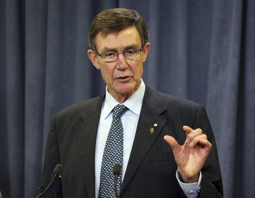 Retired Australian Air Chief Marshall Angus Houston speaks to the media during a press conference about the ongoing search operations for the missing Malaysia Airlines Flight MH370 in Perth, Australia, Sunday, April 6, 2014.