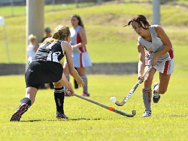 Tanisha Taylor keeps her eye on the ball during her side's match at the CQ Zone Hockey carnival in Gladstone