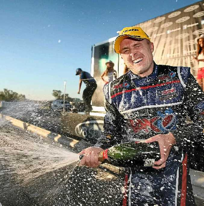 Mark Winterbottom celebrates after winning yesterday's Winton 400, in Victoria.