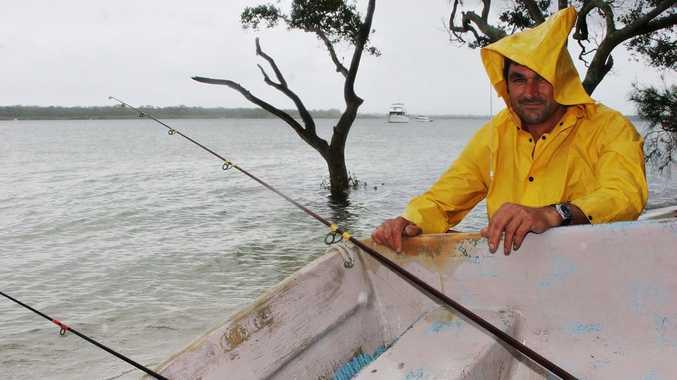 RAIN DROPS: Wet weather did not stop Mark Shipman fishing at Banksia Beach