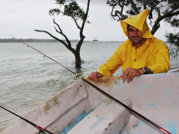 RAIN DROPS: Wet weather did not stop Mark Shipman fishing at Banksia Beach