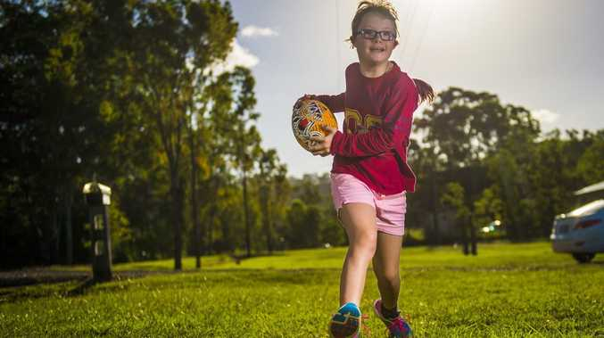 Amber Kain, 10, who has Down syndrome, will run on to the field with the Brisbane Broncos on Friday.
