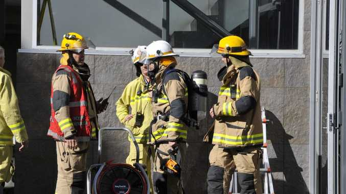 Firefighters outside the Kitchener St building. Photo Gen Kennedy / The Chronicle