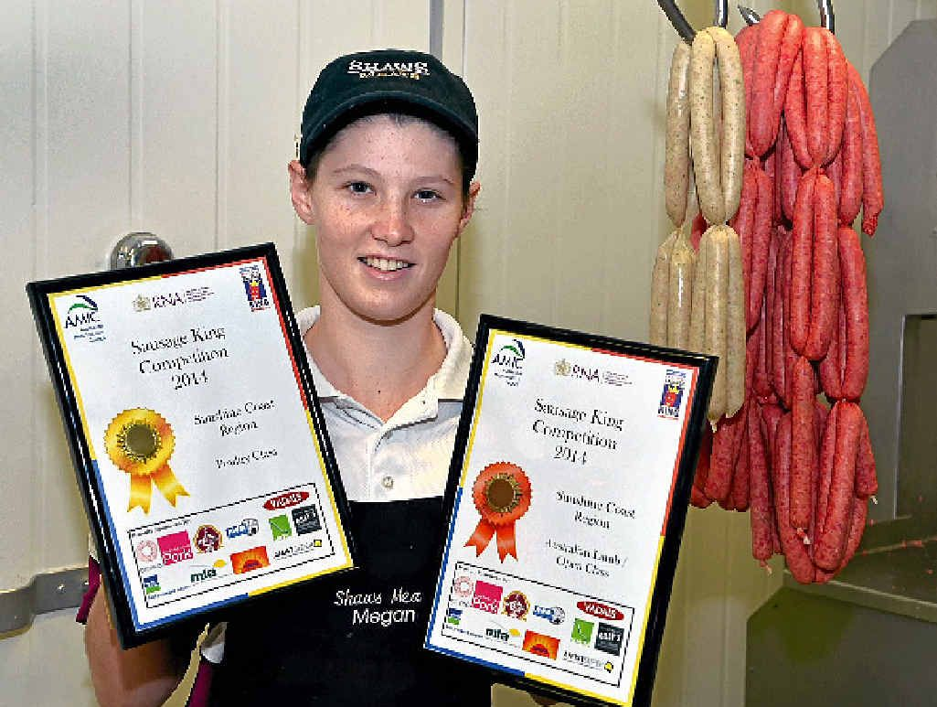 Female apprentice butcher Megan Bambling has won gold in the Sausage King competition on the weekend.