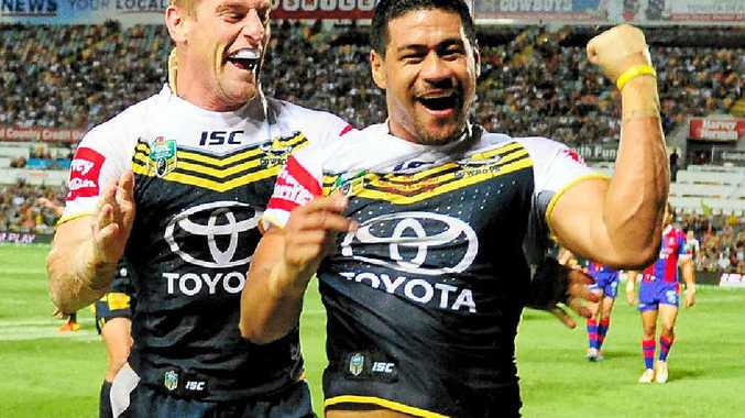Cowboys winger Matthew Wright (right) celebrates with Brent Tate after he scored a try against the Newcastle Knights at 1300SMILES Stadium in Townsville last night.