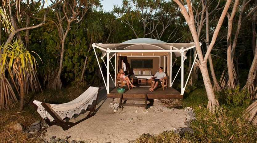 THAT'S BETTER: Chilling at a secluding hut on Wilson Island. Photo Amber Toms