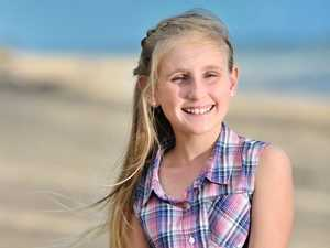 Untrained singer, 11, stops marketgoers in their tracks