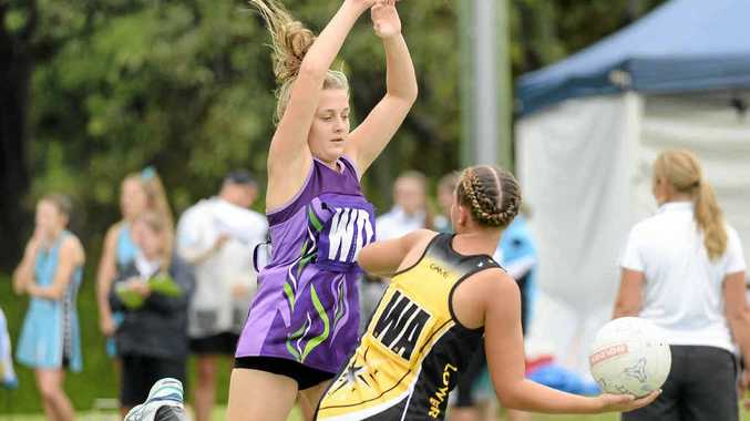 ATTEMPTED BLOCK: Grafton's Kirby Danvers (left) and Lower Clarence player Maddy Anderson during the Grafton rep netball carnival on Sunday. PHOTO: DEBRAH NOVAK