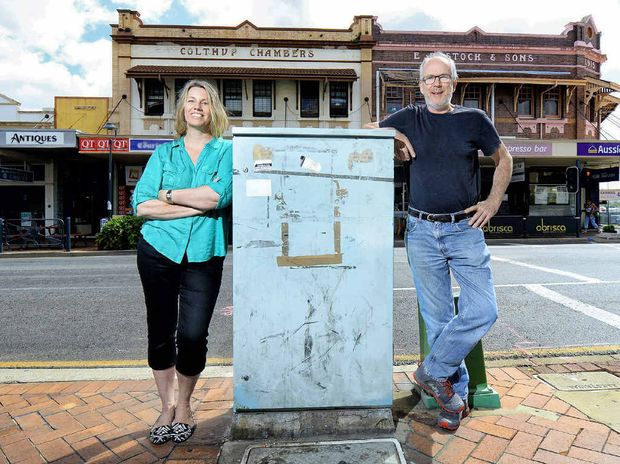 PAINT IT: Ipswich business owners Naomi George and Jim McKee support the Colour our City campaign, which will help beautify unsightly traffic signal boxes like this one in the top of town.
