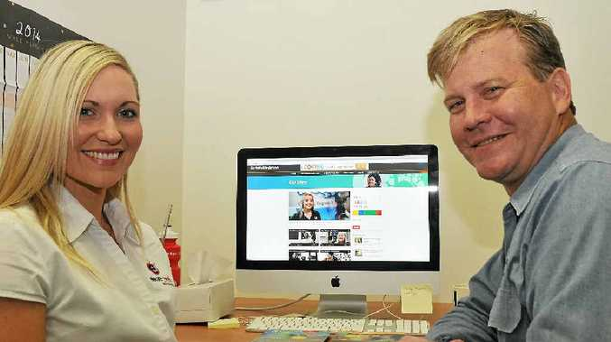 HELLO THERE: Angie Bettridge from Elevate Media and Gladstone Health Partnership member Kurt Heidecker take a look at the new Hello Gladstone website.