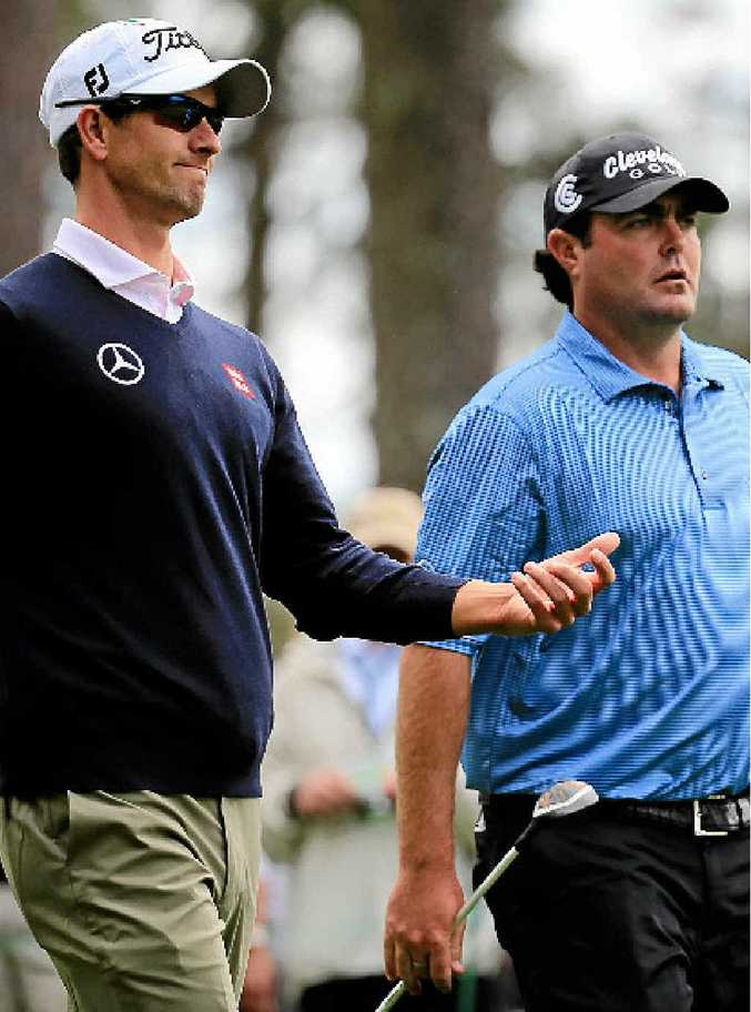 Adam Scott (left) and Steven Bowditch walk off a tee during a practice round prior to the start of the Masters.