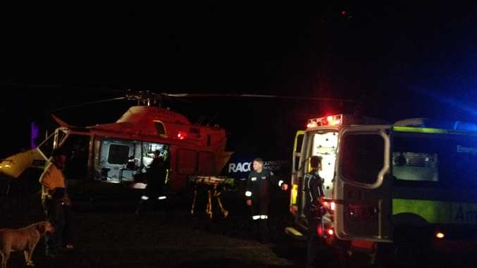 Medical crews attend to a woman who had suspected spinal injuries after falling from a horse at Mt Larcom.