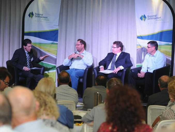 Facilitator Mark Olsen talks with Bernie Halpin from Tasman Warajay, Peter Tracy from the resource sector and Mike Barry from MFS Sugar at the Regional Development Australia State of the Region Conference in the Hervey Bay RSL.