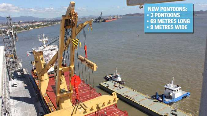 A pontoon for the new tug harbour facility is unloaded at Auckland Point Wharf in Gladstone.