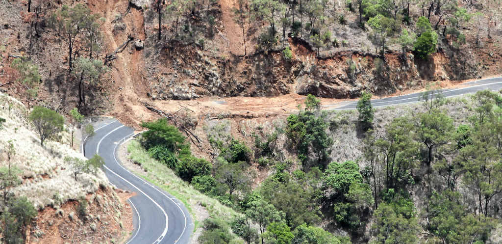 CUT OFF: Earth and rubble on the Burnett Hwy following heavy rain last year. It's likely the road will reopen in late May or early June.