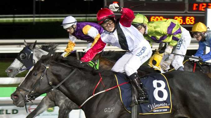 Nozi Tomizawa celebrates his victory aboard Typhoon Red in last night's Weetwood Handicap at Clifford Park.