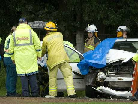 Emergency services attend a two-vehicle crash with injury on Helidon Dip Rd.
