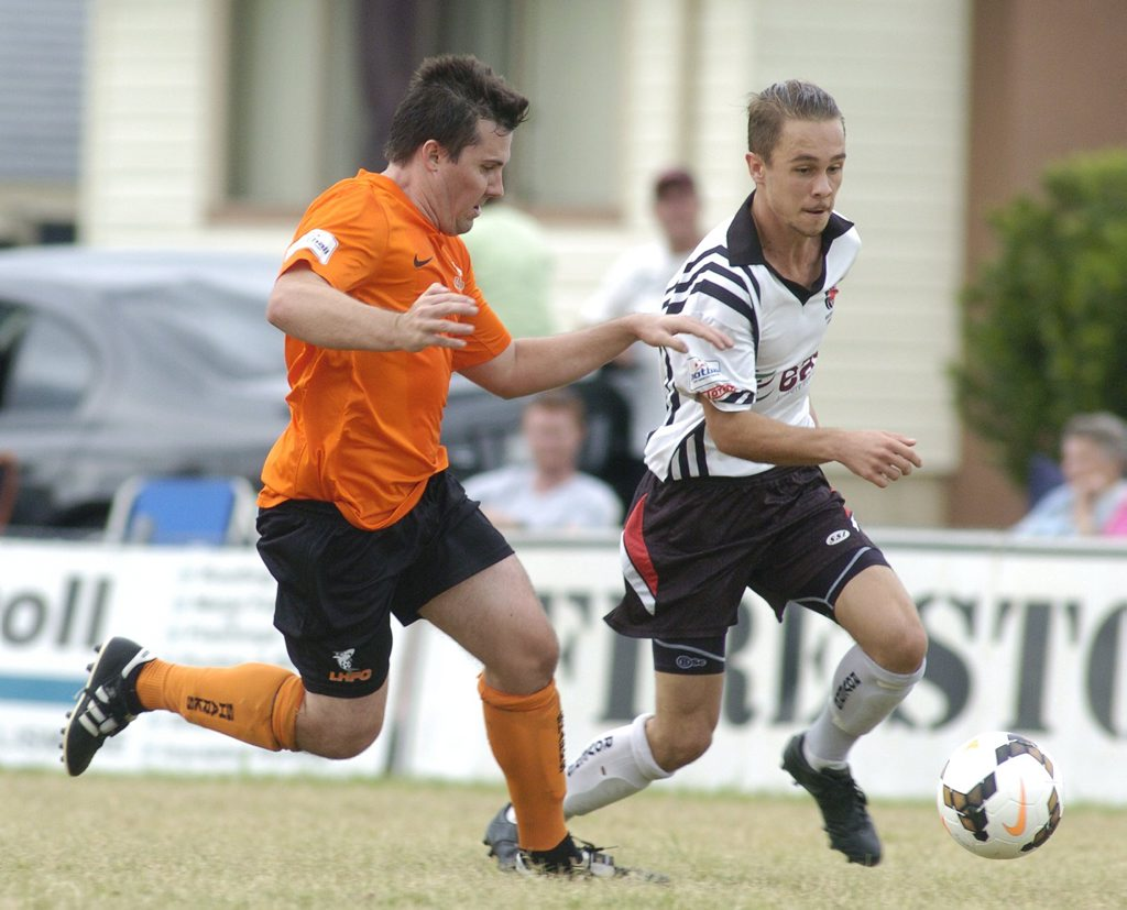 Richmond Rovers attacker Andrew Casagrande (right) tries to outrun Lennox Head Sharks defender Shaun Gillepsie during Football FNC clash.