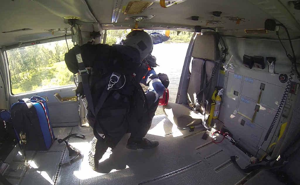 CRASH SCENE: Crew winch a plane crash survivor on board the rescue chopper on Saturday.